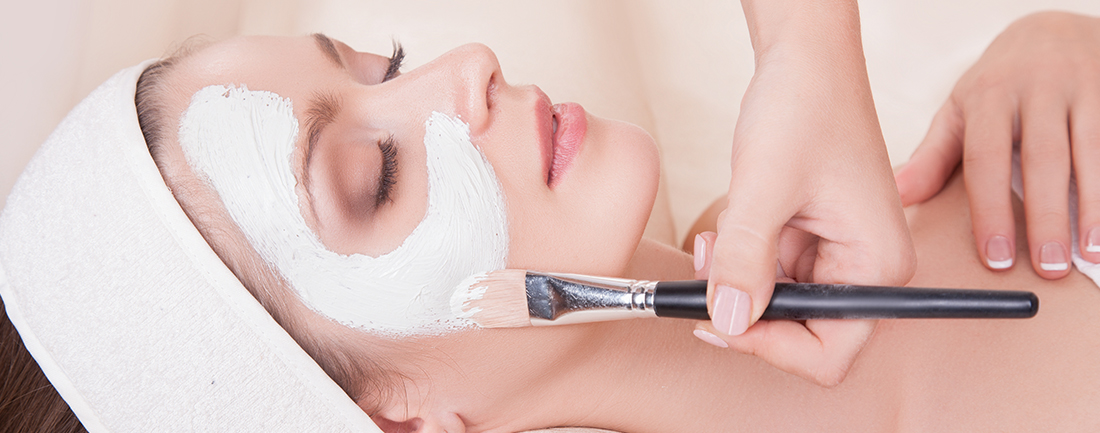 Woman with Eyes Closed Enjoying a Facial at Complexions Spa