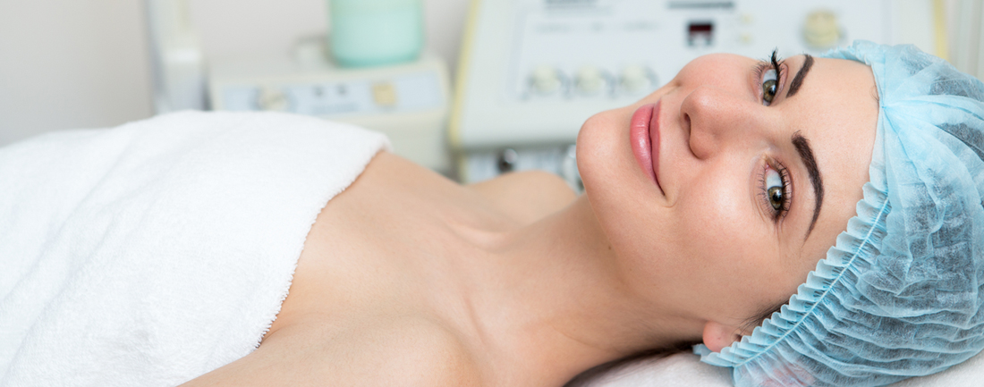 Woman Lying Down Smiling Wearing a Surgical Cap