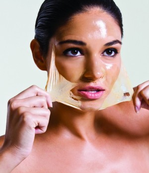 Woman Peeling Off a Skin Mask