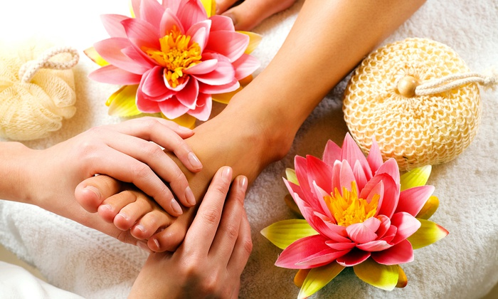 Woman Getting a Spa Pedicure with Flowers and a Loofah