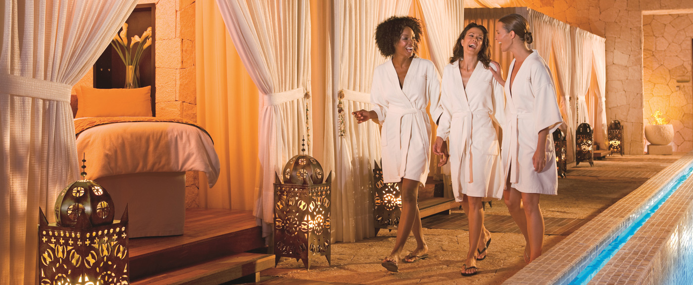 Three Women in Robes Walking to Their Spa Treatments