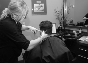 Stylist Trims a Man's Hair at the Barbershop at Complexions Spa & Salon in Albany NY