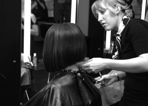 Hair Stylist at Complexions Spa Cutting a Client's Short Hair