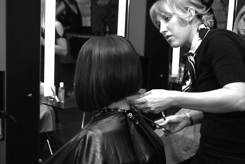 Hair Stylist at Complexions Spa Cutting a Client's Short Hair