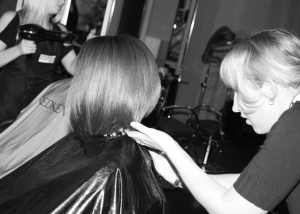Hair Stylist Cutting a Clients Hair at Complexions Spa & Salon