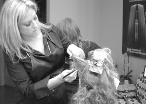 Hair Stylist at Complexions Spa & Salon Applying Foils for Highights to a Client's Hair