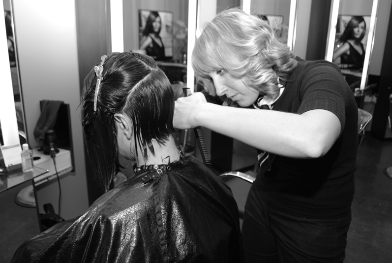 Hair Stylist at Complexions Salon in Albany NY Performing a Women's Hair Cut