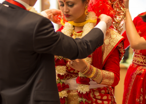 Bride in Traditional Indian Wedding Clothes with Bridal Hair & Make-Up by Complexions Spa & Salon