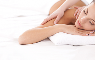 Woman Relaxing While Getting a Massage