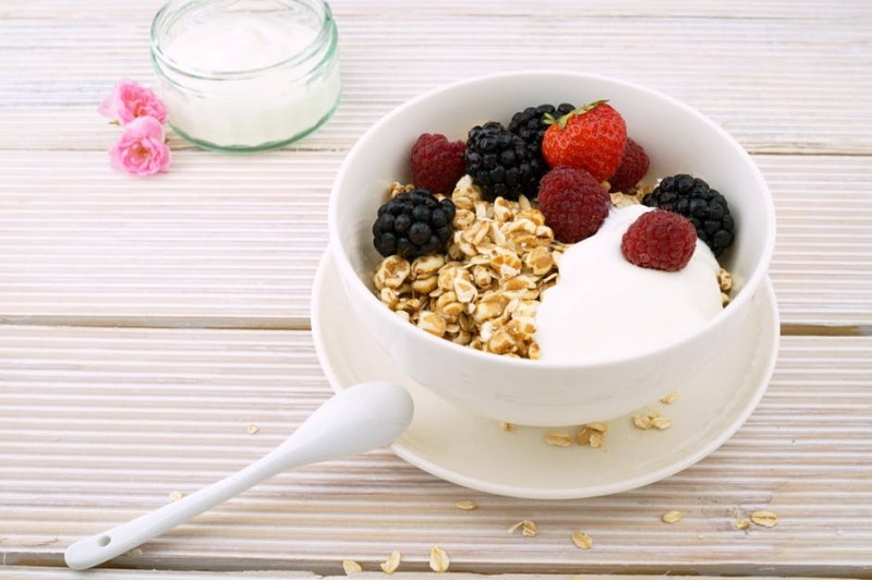 Healthy Breakfast of Oats, Yogurt & Fresh Fruit in a Bowl