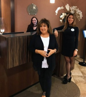 Denise Dubois, right, with two team members at Complexions Spa Albany in 2017.