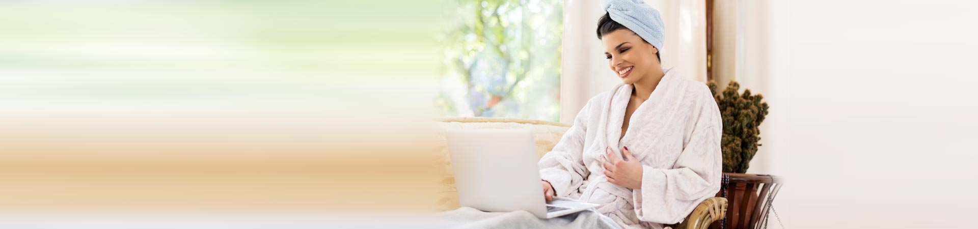 Remote Wellness Consultation - Woman on couch on laptop