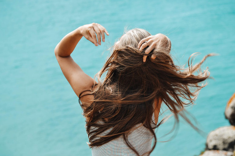 Scalp Treatments - Girl's hair blowing in the wind